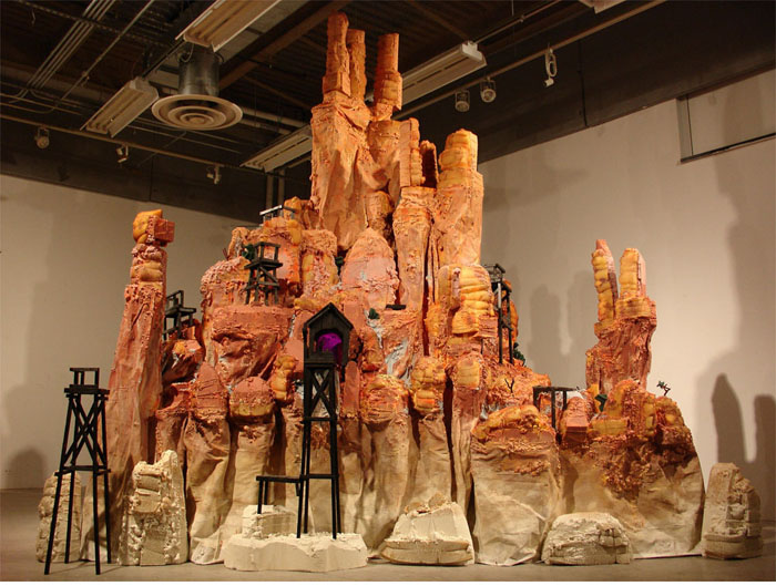 Last Stand at Big Thunder Mountain 2006 15' x 9' x 13' Styrofoam, canvas, latex paint, burnt wood, pipe cleaners and dish pads